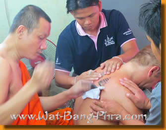 Luang Pi Nunn etches the Yantra Tattoo Gao Yord wit more then 100 stitches in a minute