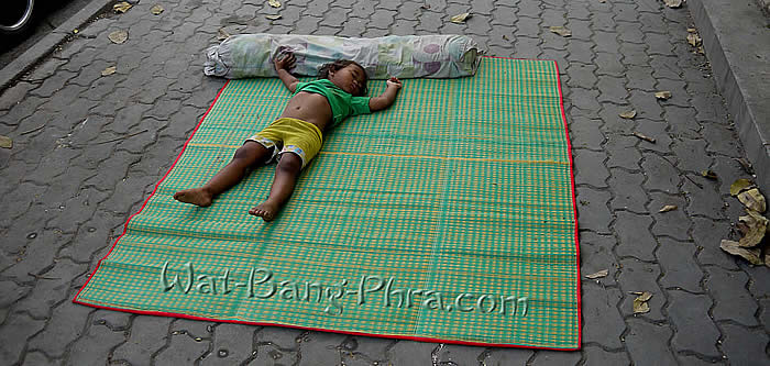 Baby sleeps in temple