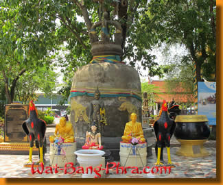 An ancient bell is guarded by holy figures and animals in the temple Wat Bang Phra